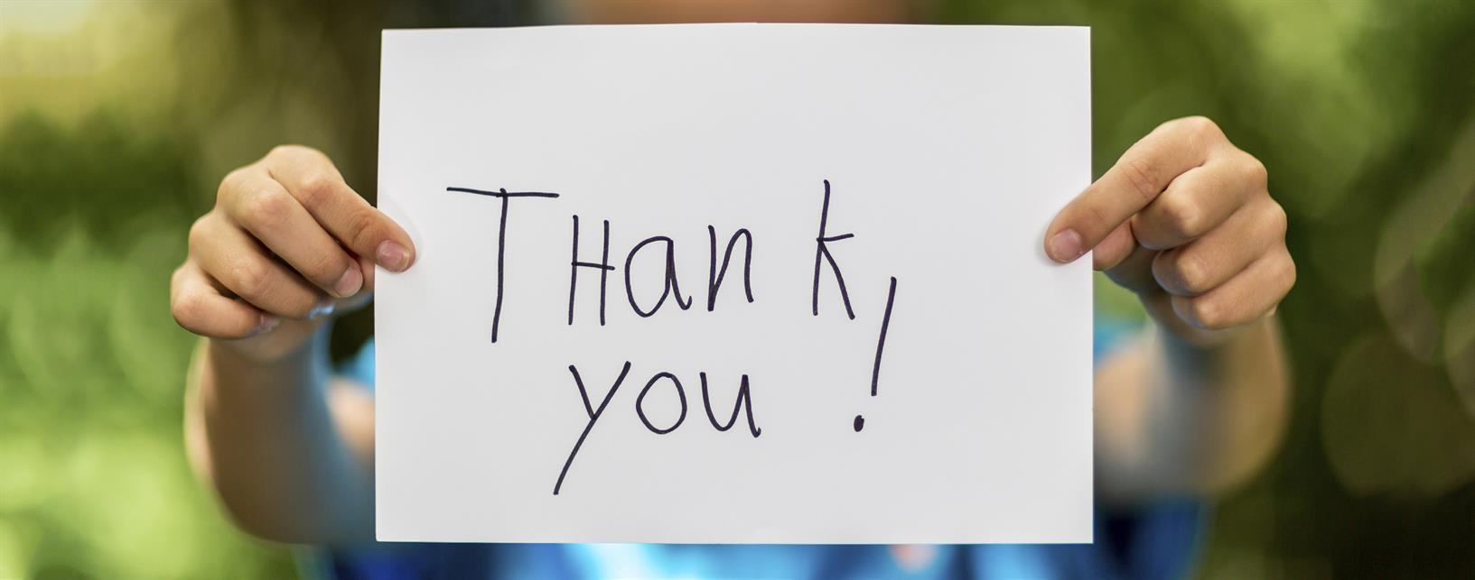 boy_holding_thank_you_sign_topofpage