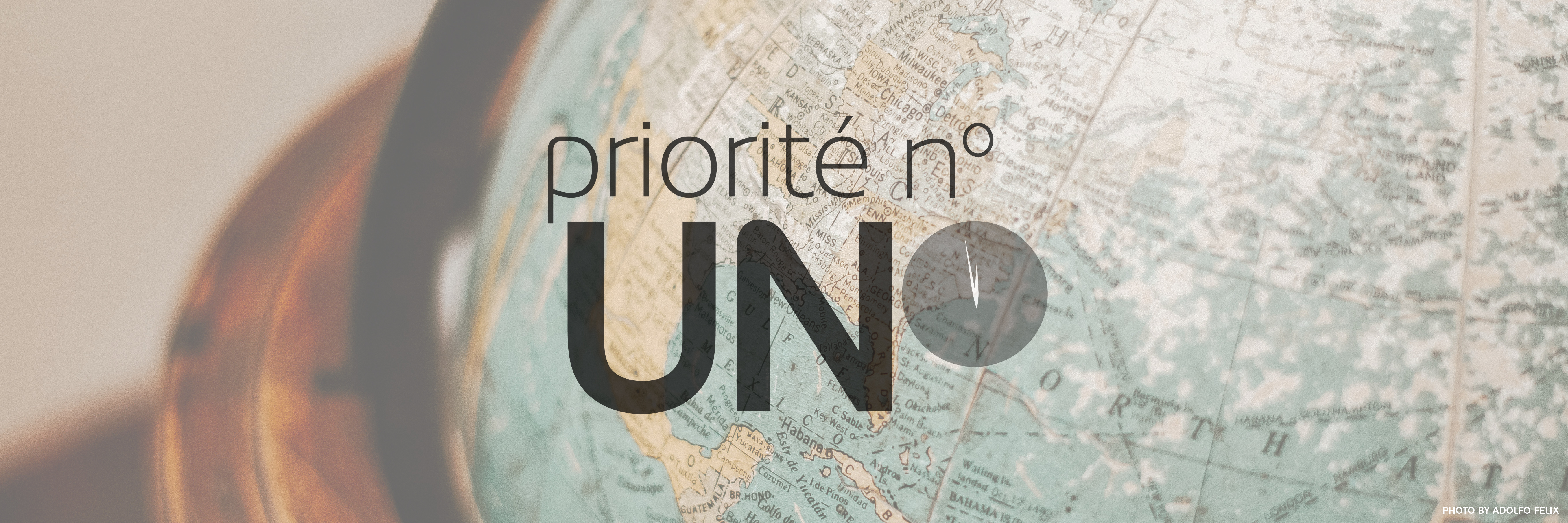 Priority ONE French logo with a world map behind it