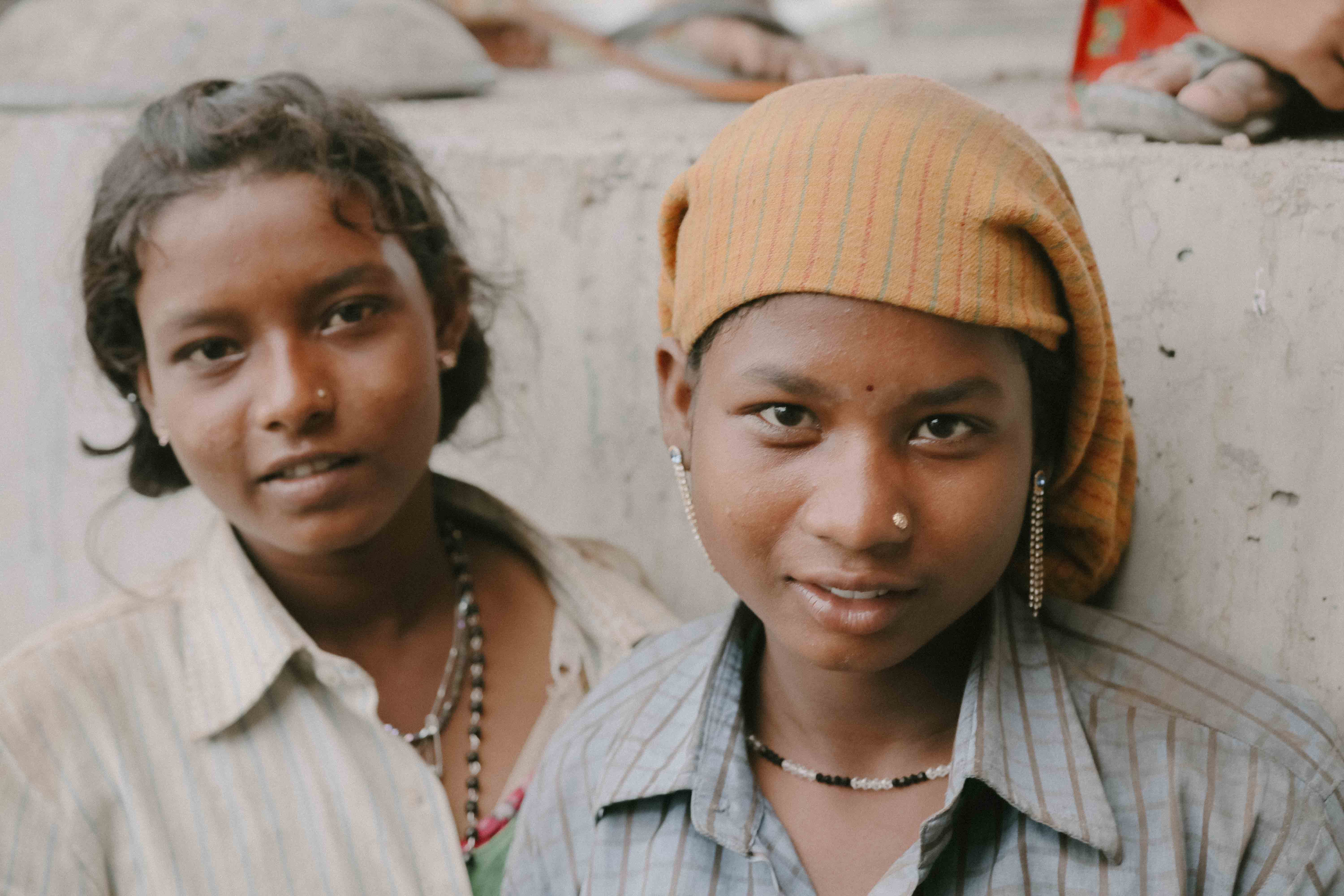Photo of two girls looking at the camera.