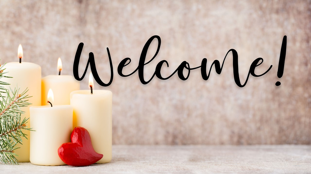 "Stock photo of Christmas candles with the text ""Welcome"" displayed"