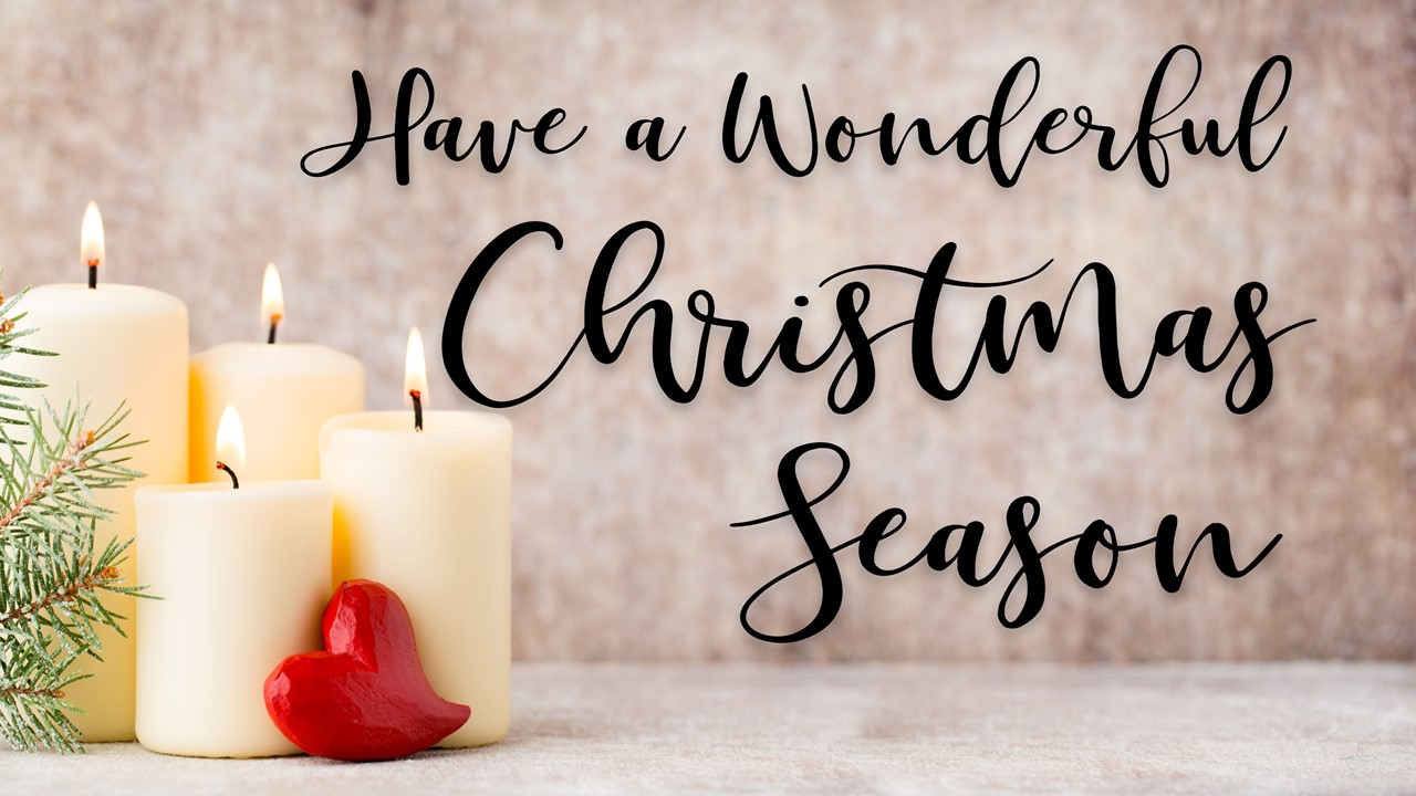 "Stock photo of Christmas candles with the words ""Have A Wonderful Christmas Season"" displayed"