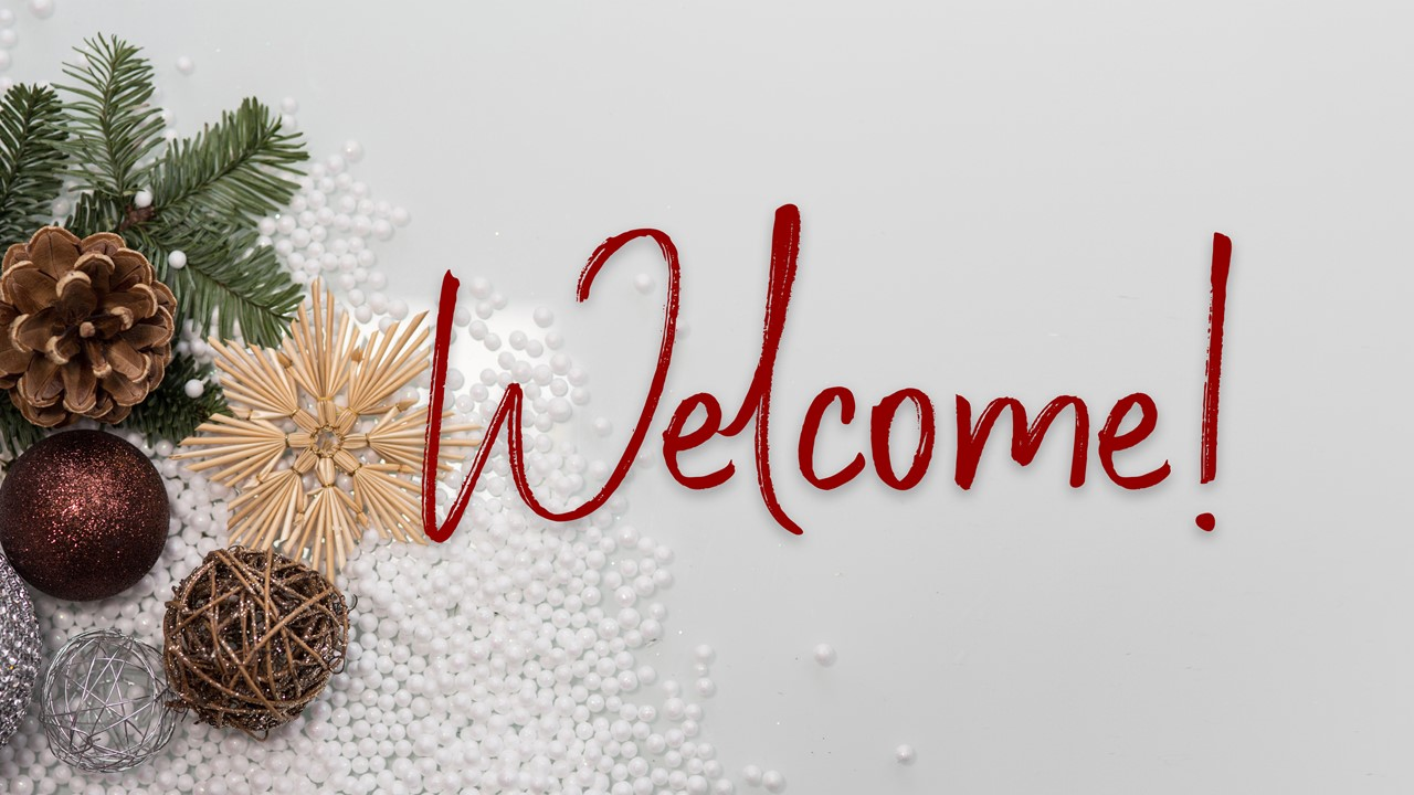 "Stock photo of minimalist Christmas greenery/decor with the text ""Welcome"" displayed"