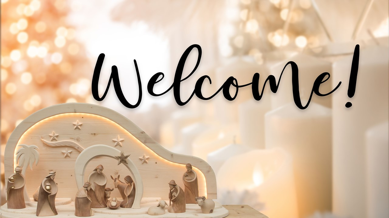 "Stock image of a Nativity scene made of wooden figures, with the words ""Welcome"" displayed"
