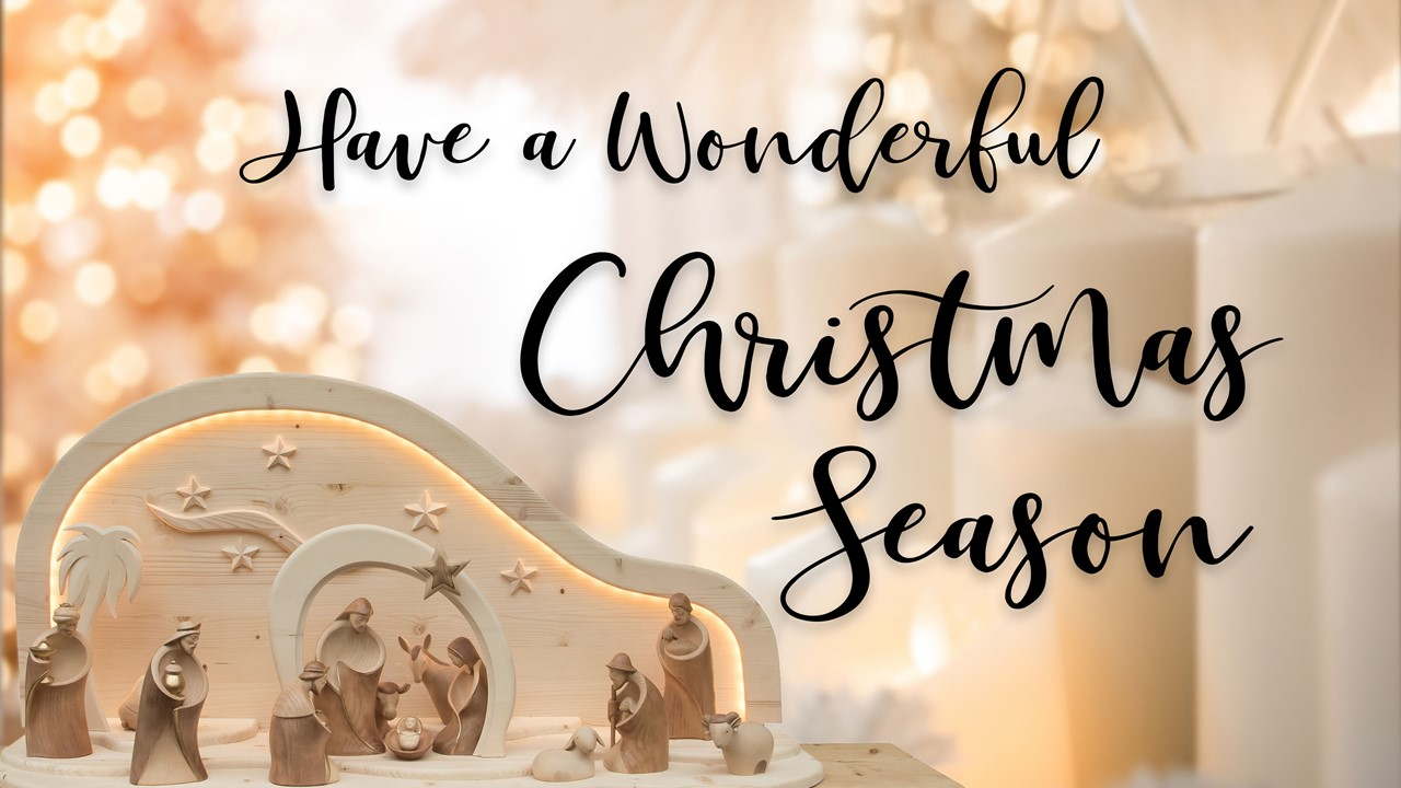 "Stock image of a Nativity scene made of wooden figures, with the words ""Have a wonderful Christmas season"" displayed"